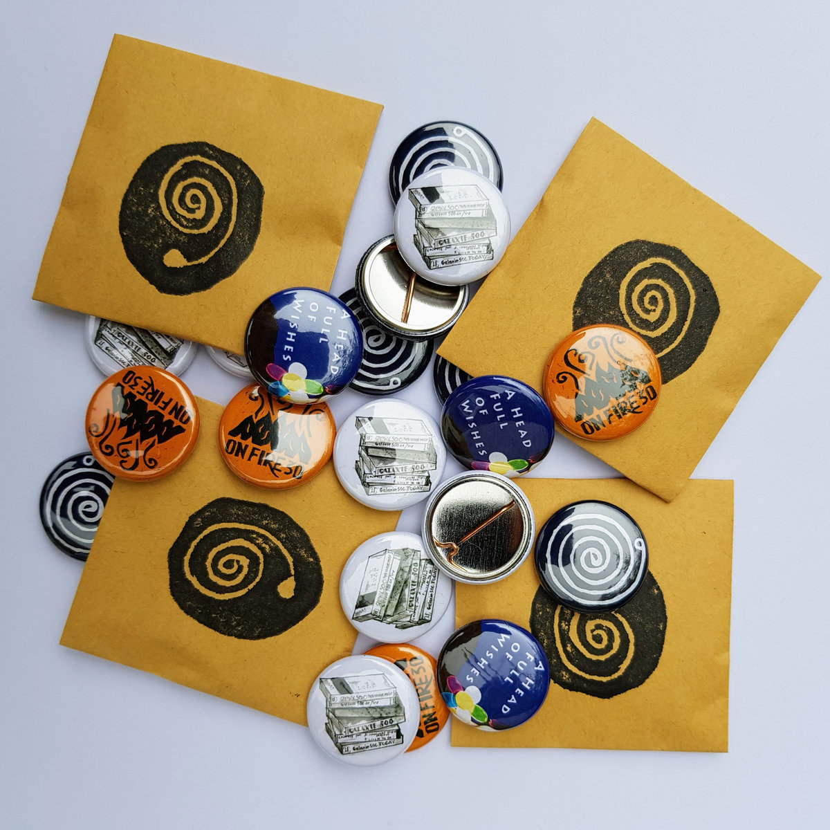 Even the badges come in cute hand-printed Naomi-earring envelopes!
