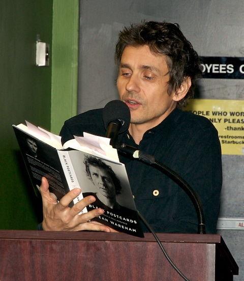 Dean reading from his memoir