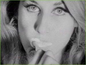Jane Holzer brushes her teeth